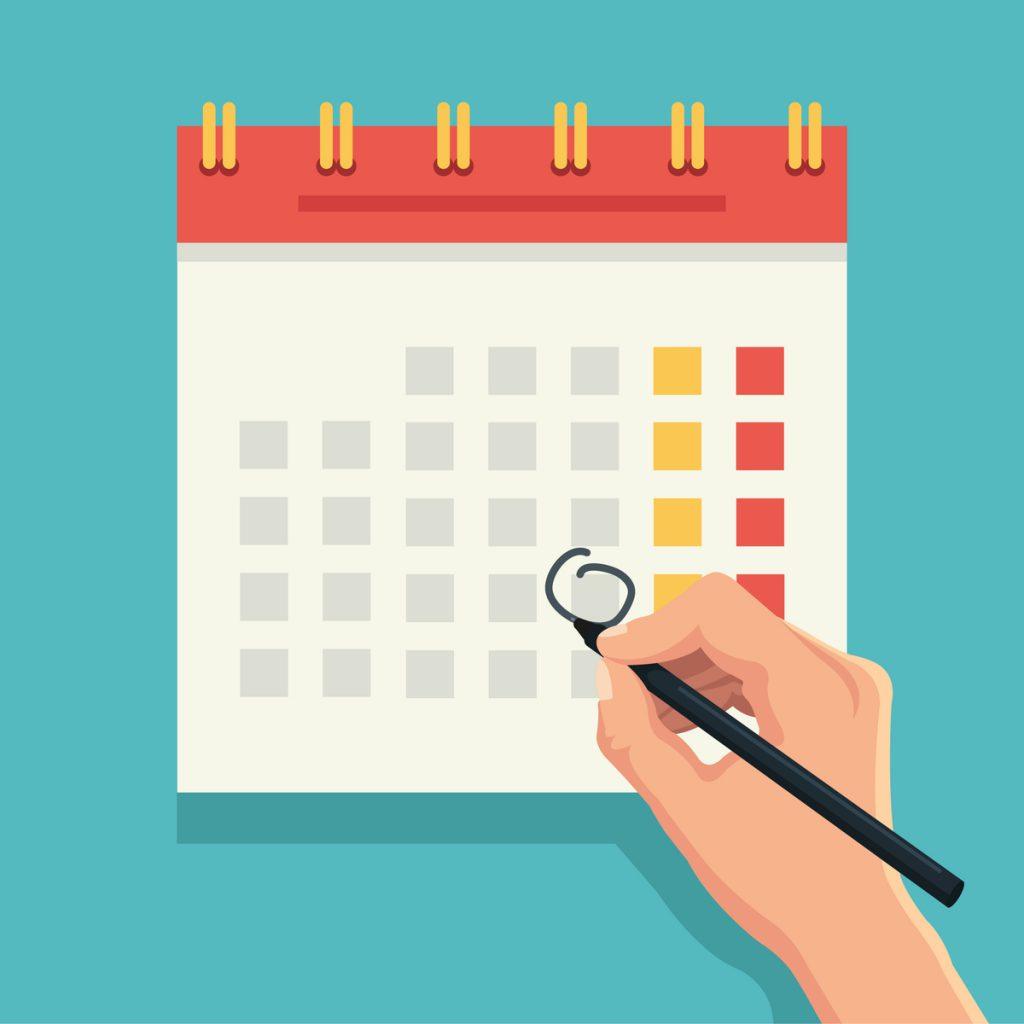 カレンダーに印をする手